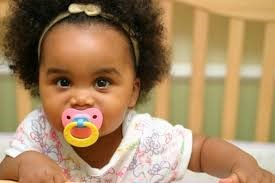 Teething baby with pacifier